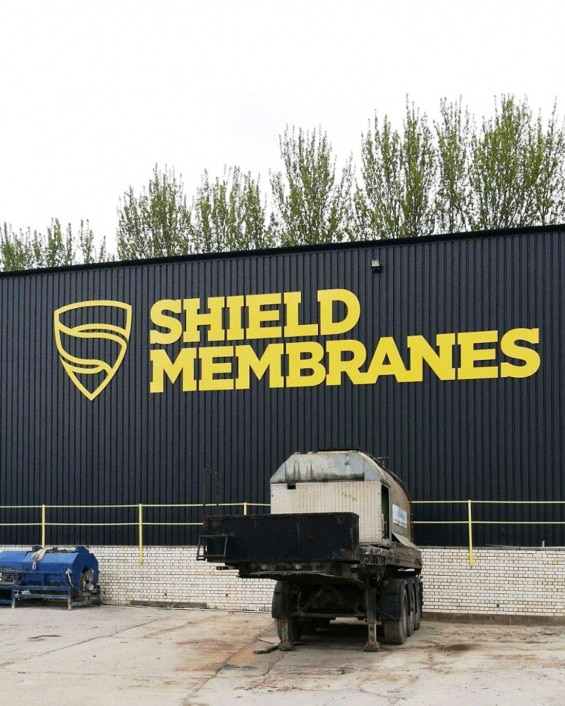 Shield Membranes logo building